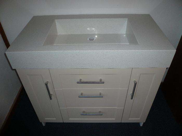 Simple Although A Bricksandmortar &quotBig Blue Box&quot Has Yet To Arrive In New Zealand  Vanity Top And Tornviken Sink Combination Shown Along With Storage Comprised