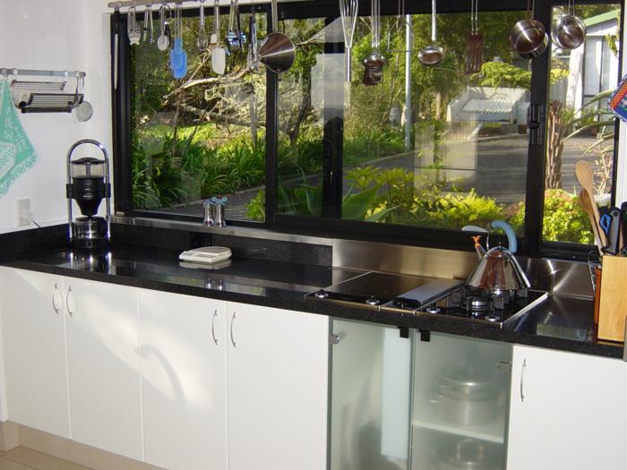 Black granit benchop glass cupboards_700x525